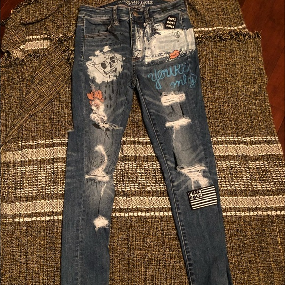 AE distressed/badged jeans